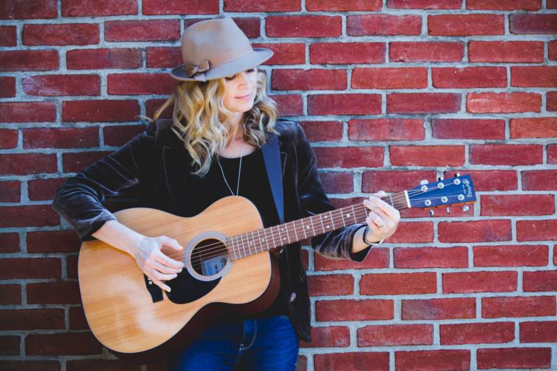 Kira with guitar